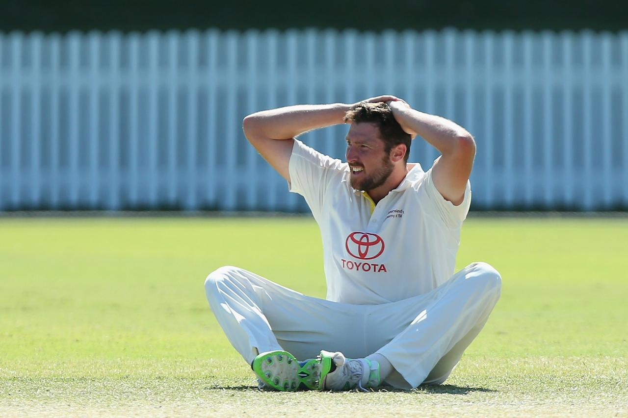 BRISBANE, AUSTRALIA - OCTOBER 03:  Luke Feldman of Queensland reacts after an unsuccessful appeal during day four of the Futures League match between Queensland and Victoria at Allan Border Field on October 3, 2013 in Brisbane, Australia.  (Photo by Chris Hyde/Getty Images)