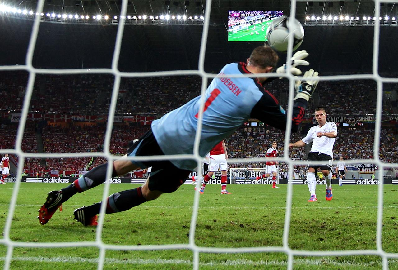 L'VIV, UKRAINE - JUNE 17: Lukas Podolski of Germany scores their first goal past Stephan Andersen of Denmark during the UEFA EURO 2012 group B match between Denmark and Germany at Arena Lviv on June 17, 2012 in L'viv, Ukraine.  (Photo by Alex Livesey/Getty Images)