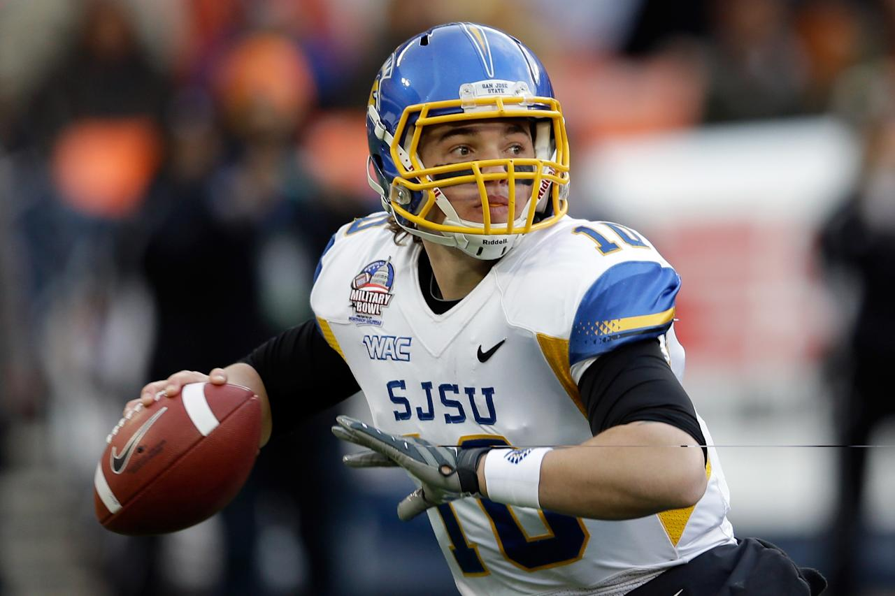 WASHINGTON, DC - DECEMBER 27:  Quarterback David Fales #10 of the San Jose State Spartans throws a pass against the Bowling Green Falcons during the first half of the Military Bowl at RFK Stadium on December 27, 2012 in Washington, DC.  (Photo by Rob Carr/Getty Images)