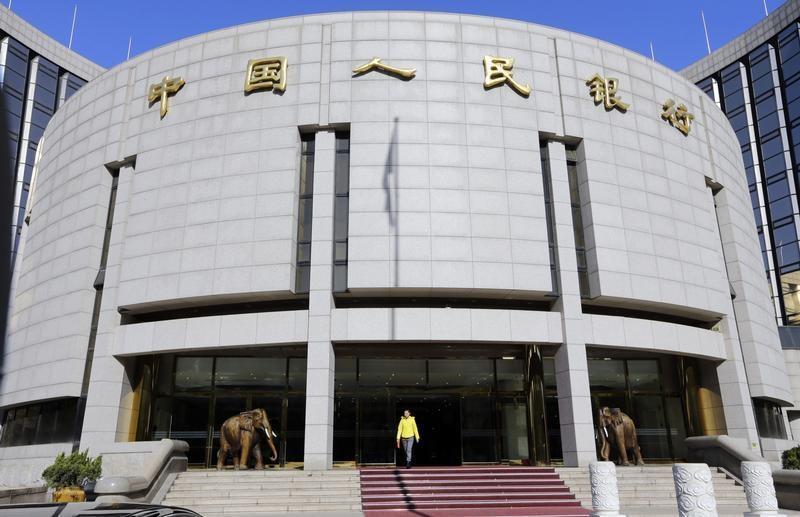 A woman walks out of the headquarters of PBOC in Beijing