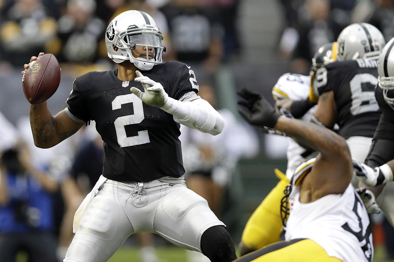 Oakland Raiders quarterback Terrelle Pryor (2) passes against the Pittsburgh Steelers during the fourth quarter of an NFL football game in Oakland, Calif., Sunday, Oct. 27, 2013. (AP Photo/Marcio Jose Sanchez)