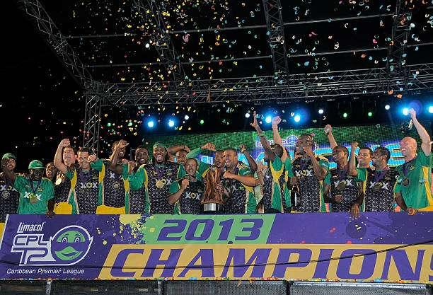 PORT OF SPAIN, TRINIDAD AND TOBAGO - AUGUST 24: The victorious Jamaica Tallawahs celebrating after winning the Final of the Cricket Caribbean Premier League between Guyana Amazon Warriors v Jamaica Tallawahs at Queen's Park Oval on August 24, 2013 in Port of Spain, Trinidad and Tobago. (Photo by Randy Brooks/Getty Images Latin America for CPL)