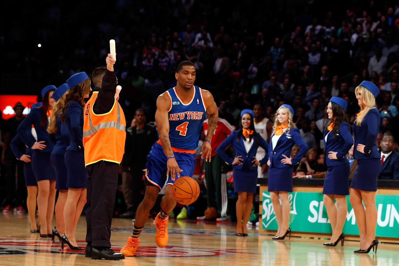 HOUSTON, TX - FEBRUARY 16: James White of the New York Knicks goes through a gauntlet of flight attendants in the first round during the Sprite Slam Dunk Contest part of 2013 NBA All-Star Weekend at the Toyota Center on February 16, 2013 in Houston, Texas. NOTE TO USER: User expressly acknowledges and agrees that, by downloading and or using this photograph, User is consenting to the terms and conditions of the Getty Images License Agreement. (Photo by Scott Halleran/Getty Images)