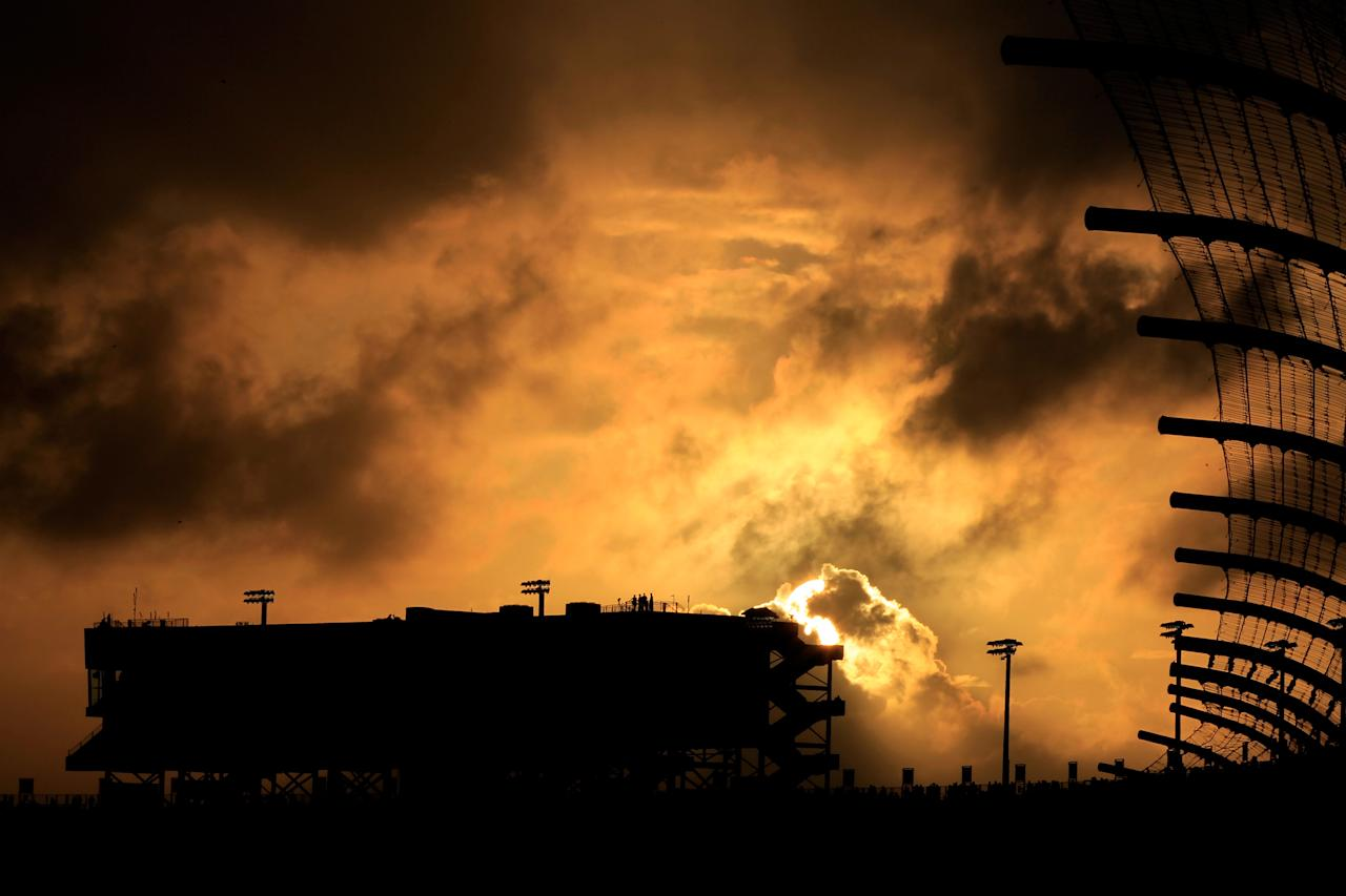 HOMESTEAD, FL - NOVEMBER 20:  A general view as the sun sets behind the grandstand during a red flag rain delay in the NASCAR Sprint Cup Series Ford 400 at Homestead-Miami Speedway on November 20, 2011 in Homestead, Florida.  (Photo by Chris Trotman/Getty Images for NASCAR)