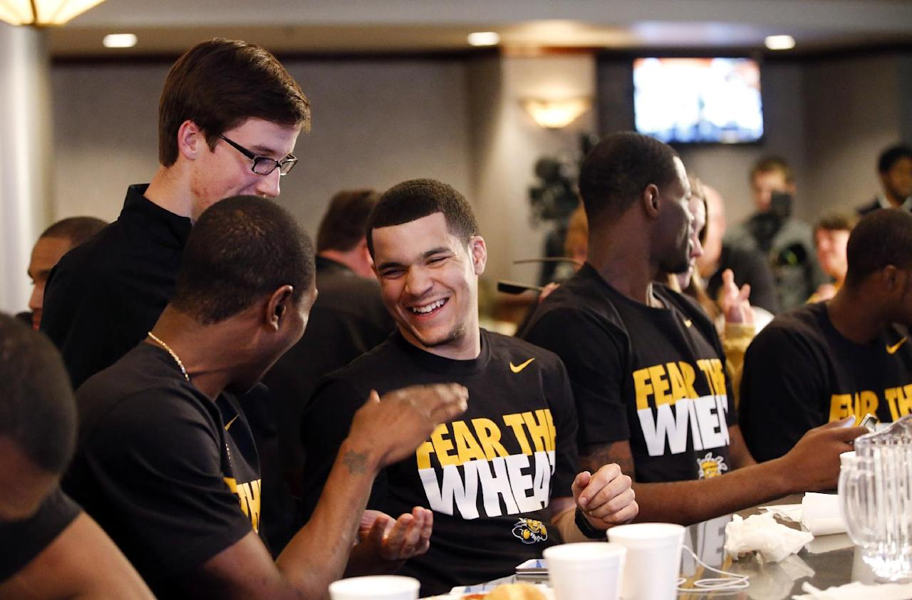 Wichita State's Cleanthony Early, left, and Fred VanVleet celebrate after the team earns a No. 1 seed during an NCAA college basketball Selection Sunday watch party, Sunday, March 16, 2014, in Wichita, Kan. (AP Photo/The Wichita Eagle, Jaime Green)