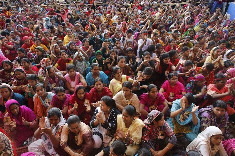 Garment workers listen to speakers during a rally demanding an increase to their minimum wage in Dhaka