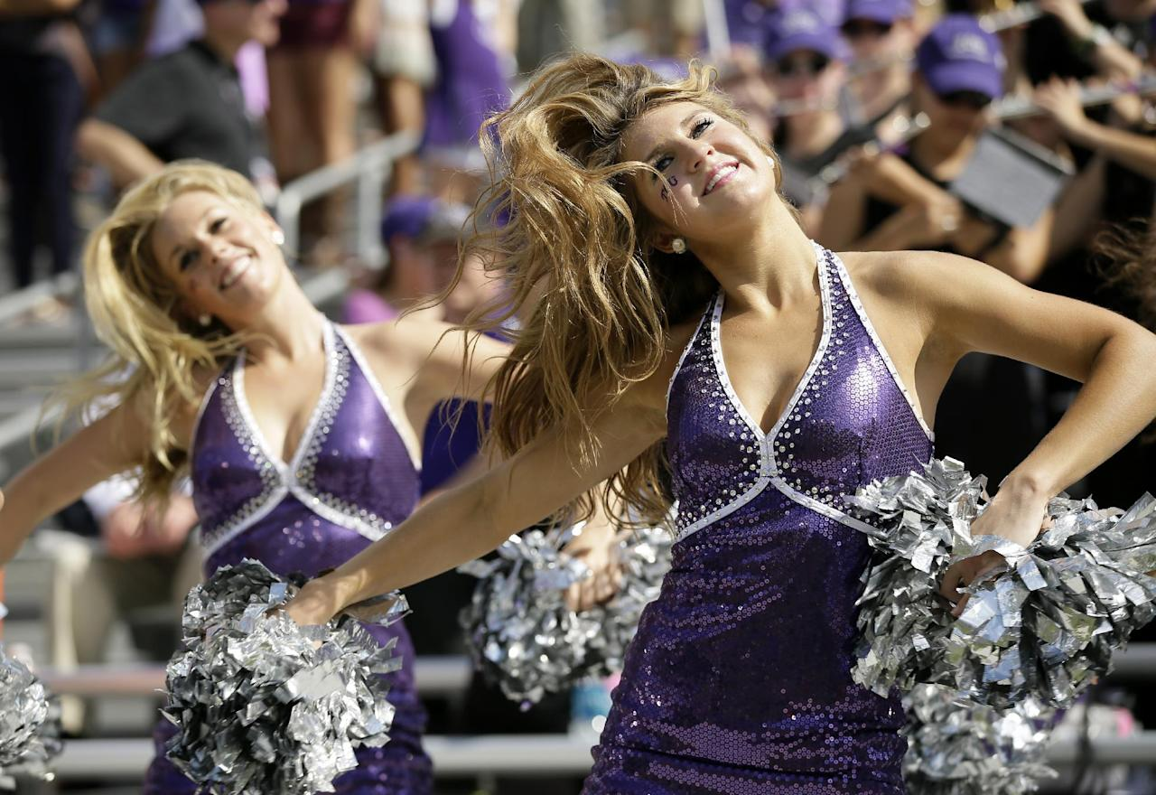 Members of the TCU Show Girls perform during the first half of an NCAA college football game against Kansas, Saturday, Oct. 12, 2013, in Fort Worth, Texas. (AP Photo/Tony Gutierrez)