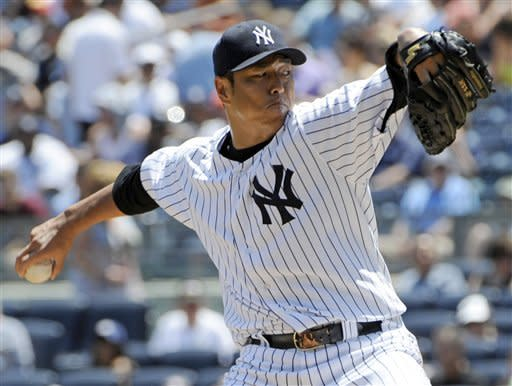 New York Yankees starter Hiroki Kuroda, of Japan, delivers a pitch to the Chicago White Sox during the first inning of a baseball game, Saturday, June 30, 2012, at Yankee Stadium in New York. (AP Photo/Bill Kostroun)