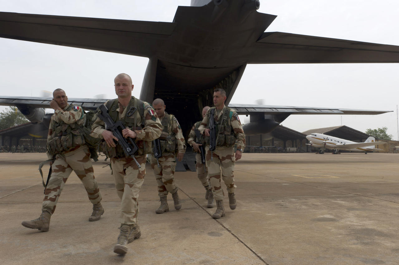 "In this picture dated Sunday, Jan. 13, 2013 and released by the French Army Communications Audiovisual office (ECPAD) shows French legionnaires of the 1st Foreign Cavalry Regiment based in Orange, southern France, exiting a military plane at Bamako airport, Mali. An official at France's Defense Ministry says the country will ""gradually deploy"" a total of 2,500 troops to Mali, and the French president says the military operation will last until security has been restored and African forces are ready to take charge. (AP Photo/Jeremy Lempin, ECPAD)"