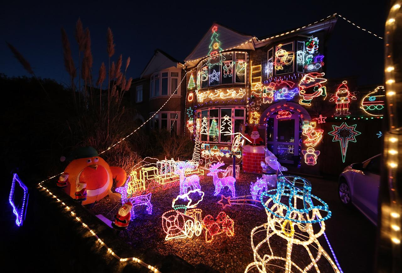 MELKSHAM, ENGLAND - DECEMBER 08:  Christmas festive lights adorn a semi-detached house in a suburban street in Melksham, December 8, 2012 in Melksham, England.   (Photo by Matt Cardy/Getty Images)