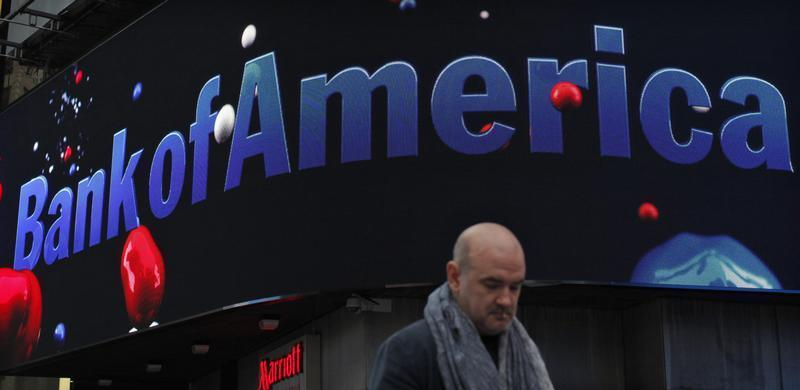 A man walks next to a Bank of America branch in New York