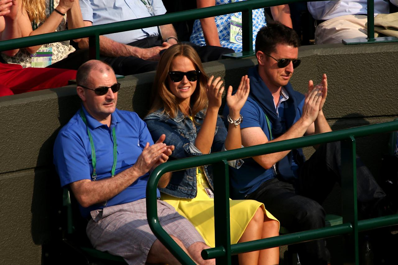 LONDON, ENGLAND - JUNE 26: Andy Murray of Great Britain's girlfriend Kim Sears and father Will Murray (L) applaud during his Gentlemen's Singles second round match against Lu Yen-Hsun of Taipei on day three of the Wimbledon Lawn Tennis Championships at the All England Lawn Tennis and Croquet Club on June 26, 2013 in London, England. (Photo by Clive Brunskill/Getty Images)
