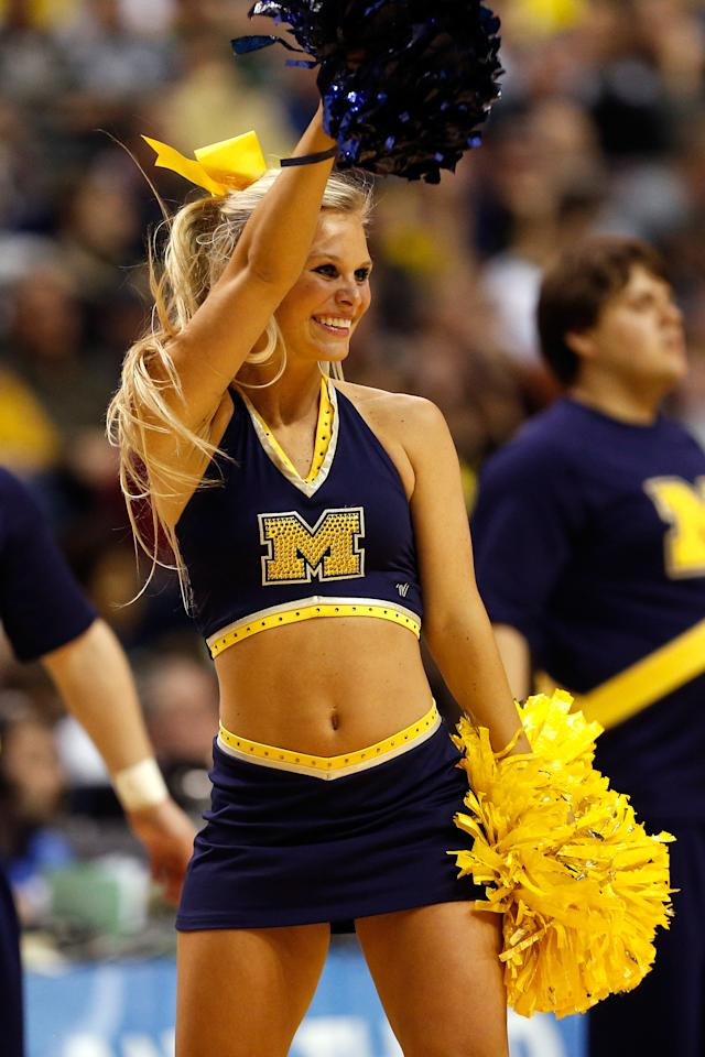 A cheerleader for the Michigan Wolverines performs against the South Dakota State Jackrabbits during the second round of the 2013 NCAA Men's Basketball Tournament at at The Palace of Auburn Hills on March 21, 2013 in Auburn Hills, Michigan.