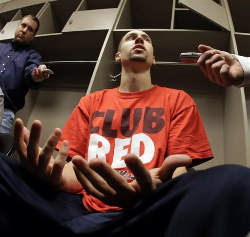 Mississippi guard Marshall Henderson talks to reporters in the locker room after practice for a third-round game in the NCAA college basketball tournament  on Saturday, March 23, 2013, in Kansas City, Mo. Mississippi plays La Salle in Sunday. (AP Photo/Charlie Riedel)