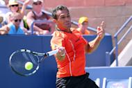 Aug 30, 2014; New York, NY, USA; Victor Estrella Burgos (DOM) returns a shot to Milos Raonic (CAN) on the Grandstand Court on day six of the 2014 U.S. Open tennis tournament at USTA Billie Jean King National Tennis Center. (Anthony Gruppuso-USA TODAY Sports)
