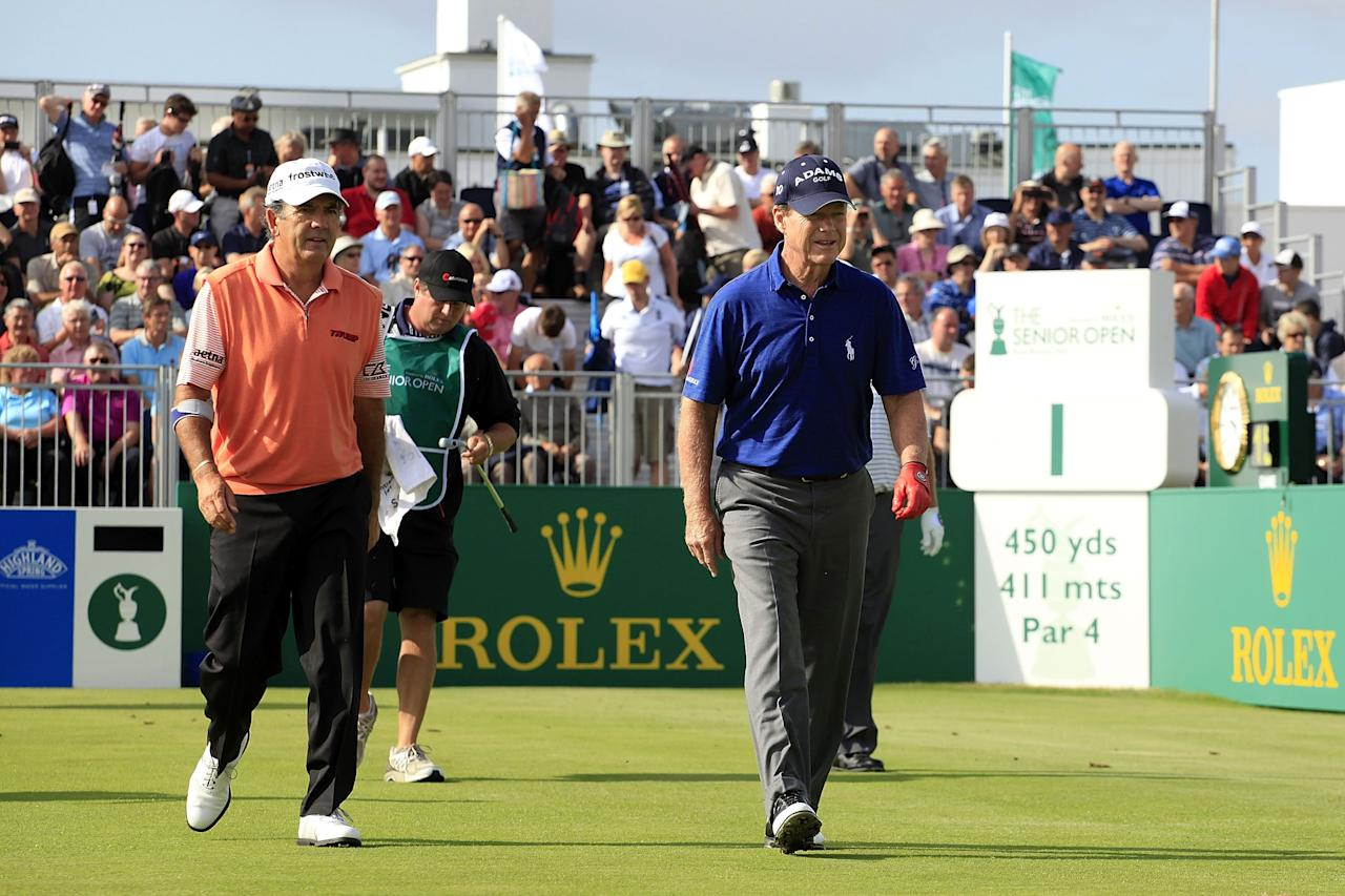 SOUTHPORT, ENGLAND - JULY 25: Tom Watson of United States and David Frost of South Africa walk from the 1st tee during the first round of The Senior Open Championship played at Royal Birkdale Golf Club on July 25, 2013 in Southport, United Kingdom. (Photo by Phil Inglis/Getty Images)