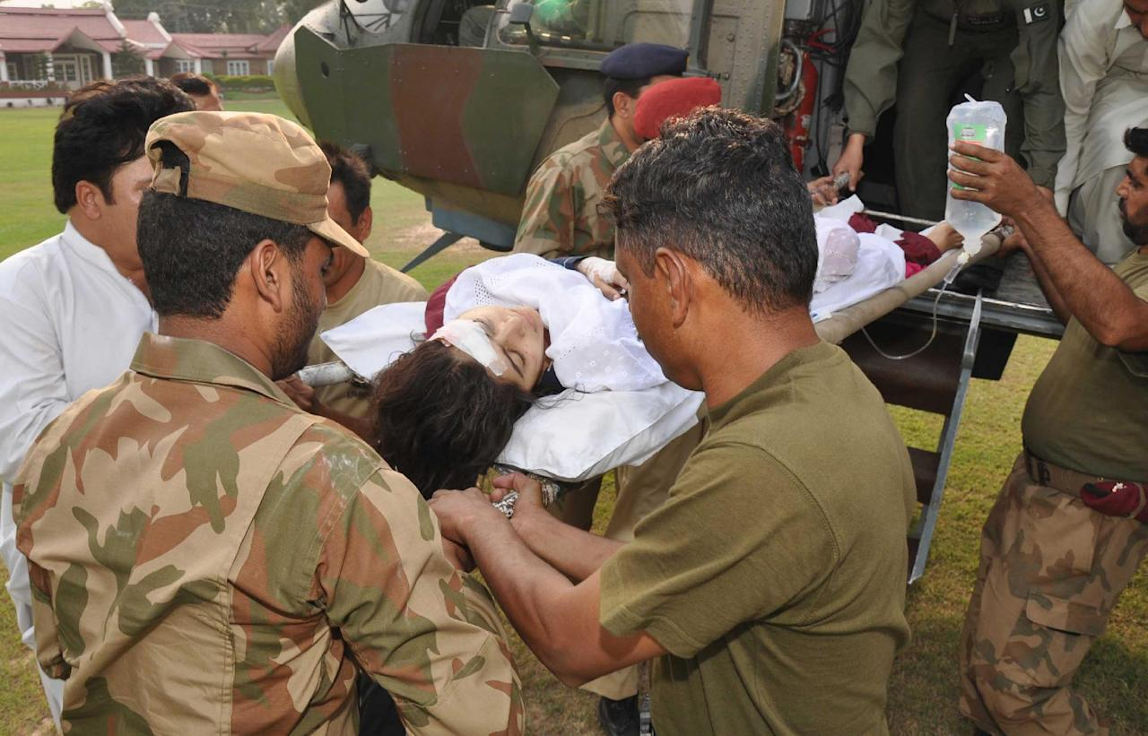 In this photo released by Inter Services Public Relations department, Pakistani soldiers carry wounded Pakistani girl, Malala Yousufzai, from a military helicopter to a military hospital in Peshawar, Pakistan. A Taliban gunman walked up to a bus taking children home from school in Pakistan's volatile Swat Valley Tuesday and shot and wounded the 14-year-old activist known for championing the education of girls and publicizing atrocities committed by the Taliban, officials said. (AP Photo/Inter Services Public Relations Department)