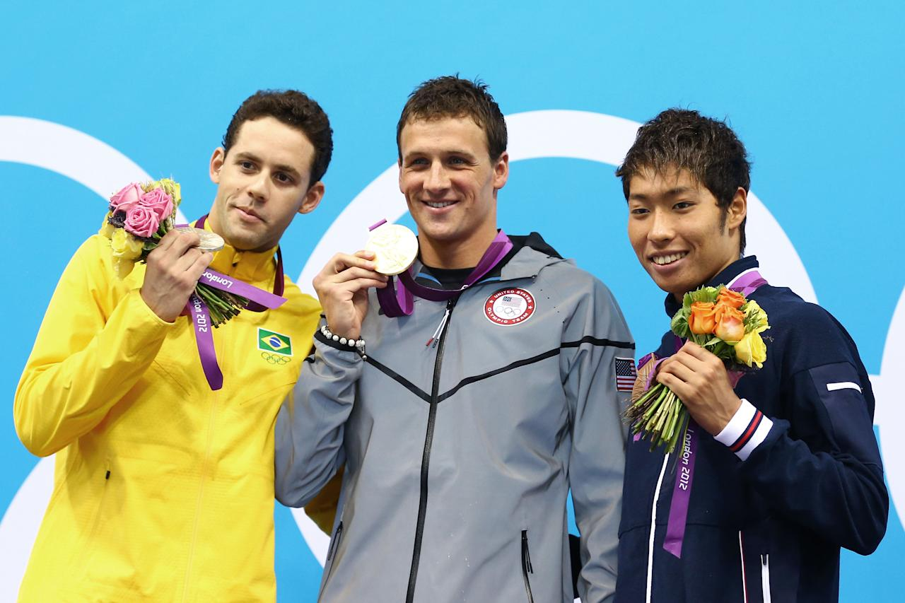 LONDON, ENGLAND - JULY 28:  (L-R) Silver medalist Thiago Pereira of Brazil, Gold medalist Ryan Lochte of the United States and Bronze medalist Kosuke Hagino of Japan celebrate with their medals during the Medal Ceremony for the Men's 400m Individual Medley on Day One of the London 2012 Olympic Games at the Aquatics Centre on July 28, 2012 in London, England.  (Photo by Al Bello/Getty Images)
