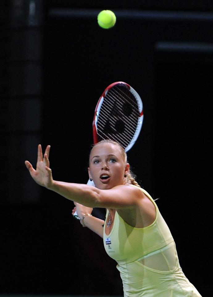 Caroline Wozniacki of Denmark hits a return to Agnieszka Radwanska of Poland during their WTA tennis championships match in Istanbul on October 25, 2011. AFP PHOTO/BULENT KILIC (Photo credit should read BULENT KILIC/AFP/Getty Images)