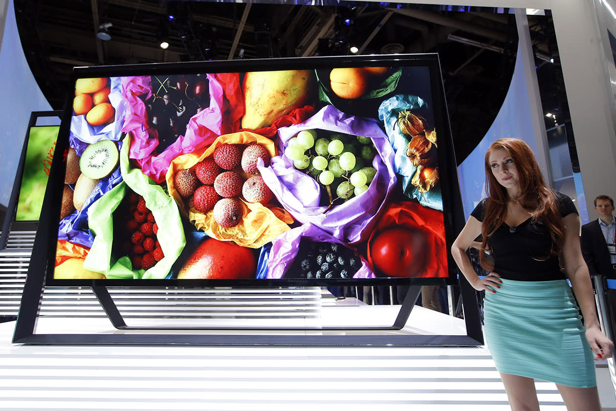 A model stands next to Samsung 110-inch 4k Ultra HD TV at the Samsung booth at the International Consumer Electronics Show.