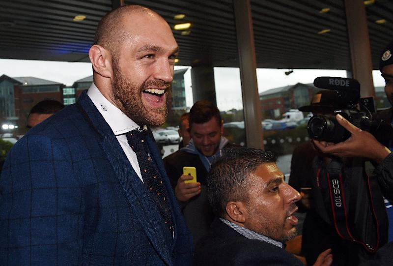 Britain's world heavyweight champion Tyson Fury, pictured in Bolton on November 30, 2015, opted to travel home by car from Germany via the Dutch port of Rotterdam, taking a ferry to Hull