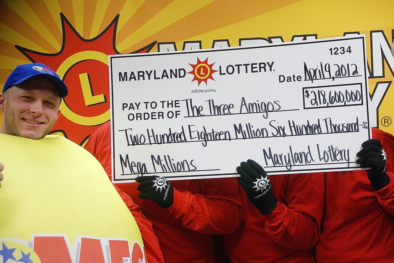 <b>$656 million</b><br><br>Maryland State Lottery Agency, a lottery official, left, and the three anonymous winners of the Maryland portion of the Mega Millions lottery pose for a photo in Baltimore, Monday, April 9, 2012. Maryland Lottery officials say three public school employees are sharing the spoils of the record Mega Millions jackpot. The winning Maryland ticket is one of three nationally that split the $656 million jackpot.