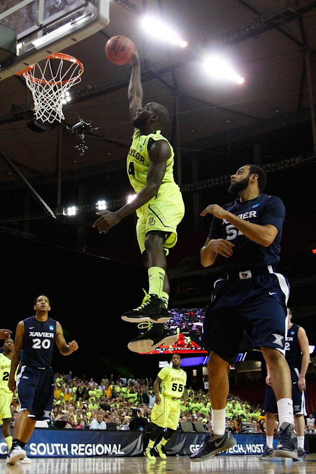 ATLANTA, GA - MARCH 23:  Quincy Acy #4 of the Baylor Bears dunks against the Xavier Musketeers in the first half during the 2012 NCAA Men's Basketball South Regional Semifinal game at the Georgia Dome on March 23, 2012 in Atlanta, Georgia.  (Photo by Kevin C. Cox/Getty Images)