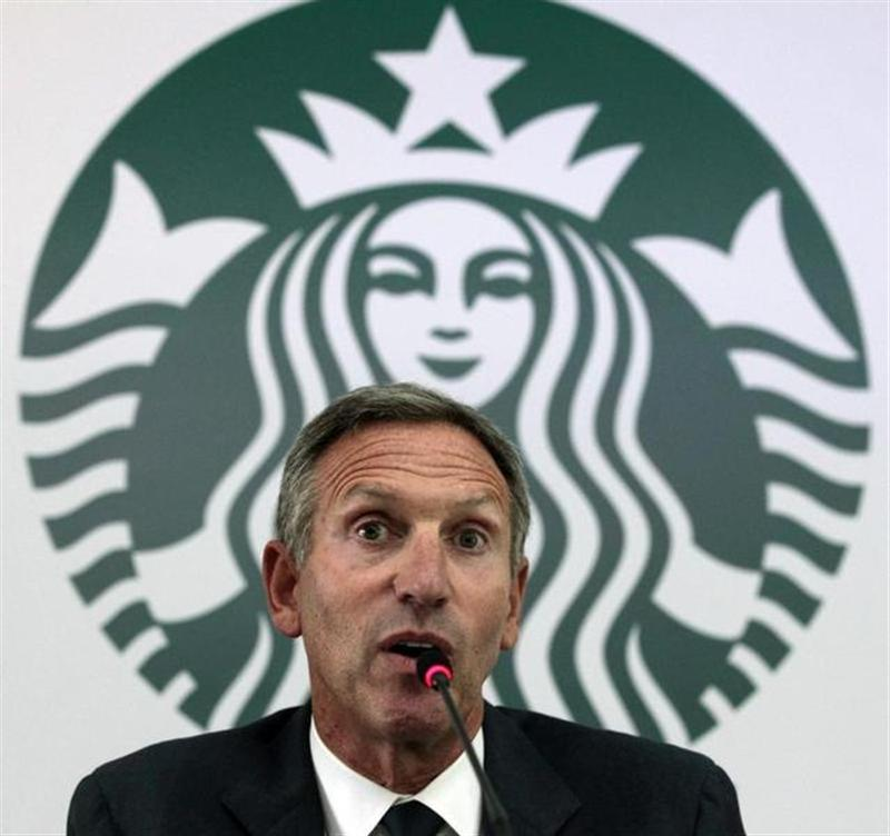 Starbucks Chairman and CEO Schultz speaks during a news conference at a hotel in Bogota