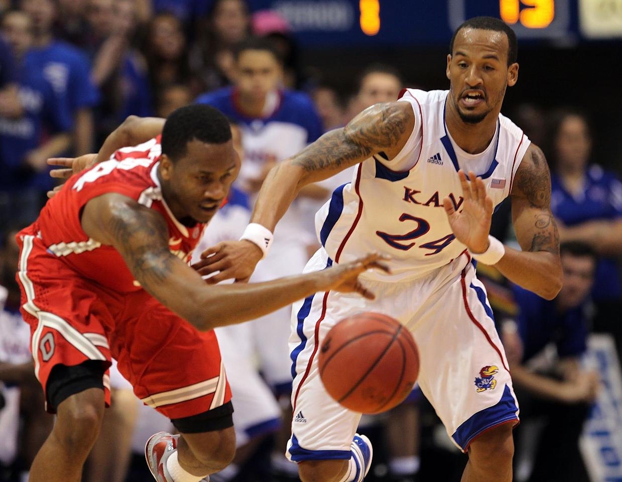 LAWRENCE, KS - DECEMBER 10:  Travis Releford #24 of the Kansas Jayhawks knocks the ball loose from the hands of William Buford #44 of the Ohio State Buckeyes during the game on December 10, 2011 at Allen Fieldhouse in Lawrence, Kansas.  (Photo by Jamie Squire/Getty Images)