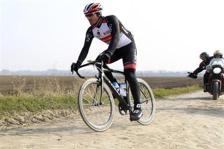Radioshack rider Fabian Cancellara of Switzerland cycles on a cobble-stoned section of the Paris-Roubaix cycling race during training in Haveluy