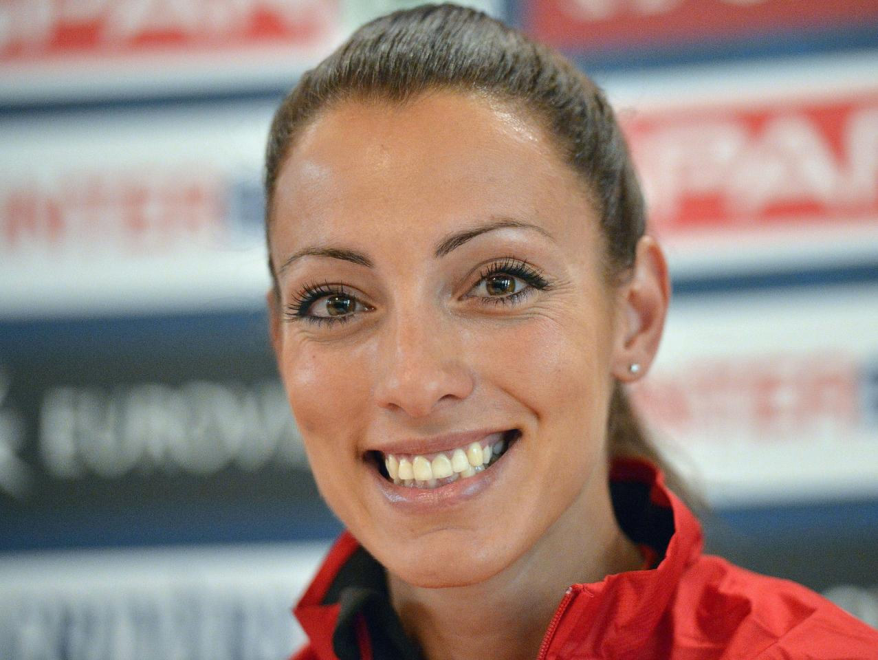 Bulgaria's sprinter Ivet Lalova smiles during a press conference at the European Athletics Championships in Helsinki, Finland, Tuesday, June 26, 2012. (AP Photo/Martin Meissner)