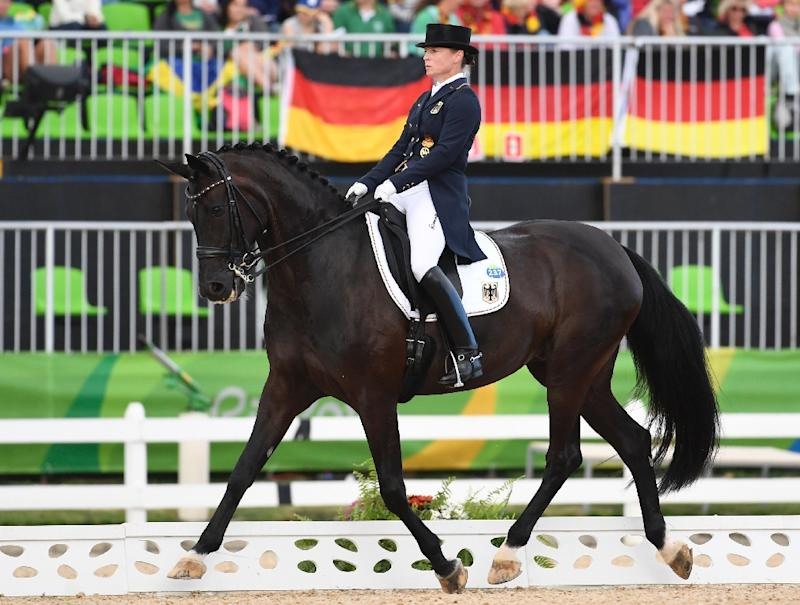 Charlotte Dujardin, Carl Hester, Fiona Bigwood and Spencer WIlton win dressage silver