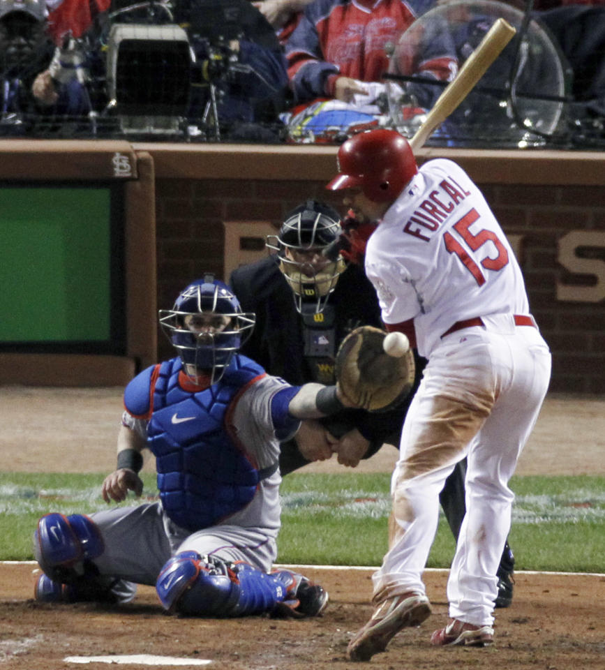 Texas Rangers' C.J. Wilson hits St. Louis Cardinals' Rafael Furcal with a pitch during the fifth inning of Game 7 of baseball's World Series Friday, Oct. 28, 2011, in St. Louis. Texas Rangers' Mike Napoli catches. (AP Photo/Jeff Roberson)