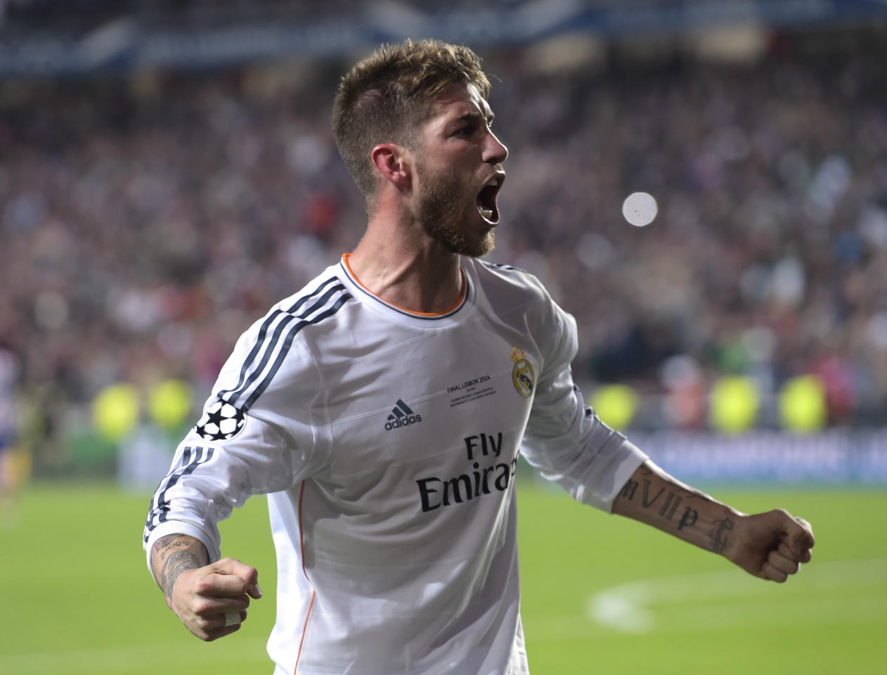 Real's Sergio Ramos, gestures, after scoring his side's first goal , during the Champions League final soccer match between Atletico Madrid and Real Madrid, at the Luz stadium, in Lisbon, Portugal, Saturday, May 24, 2014. (AP Photo/Manu Fernandez)