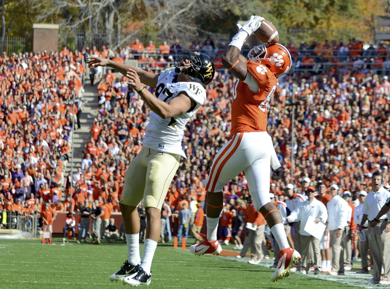 Clemson's Brandon Ford, right, pulls down a second quarter reception for a first down over Wake Forest's Matt James during an NCAA college football game against Wake Forest  Saturday, Nov. 12, 2011, at Memorial Stadium in Clemson, S.C.  (AP Photo/ Richard Shiro)