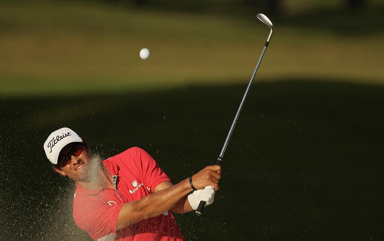 MIAMI, FL - MARCH 10:  Adam Scott of Australia hits a bunker shot on the 17th hole during the third round of the World Golf Championships-Cadillac Championship on the TPC Blue Monster at Doral Golf Resort And Spa on March 10, 2012 in Miami, Florida.  (Photo by Scott Halleran/Getty Images)