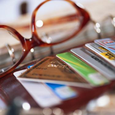 Wallet-full-of-credit-cards-with-glasses_web