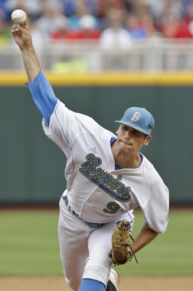 UCLA's starting pitcher Adam Plutko works against Stony Brook in the first inning of an NCAA College World Series baseball game in Omaha, Neb., Friday, June 15, 2012. (AP Photo/Nati Harnik)