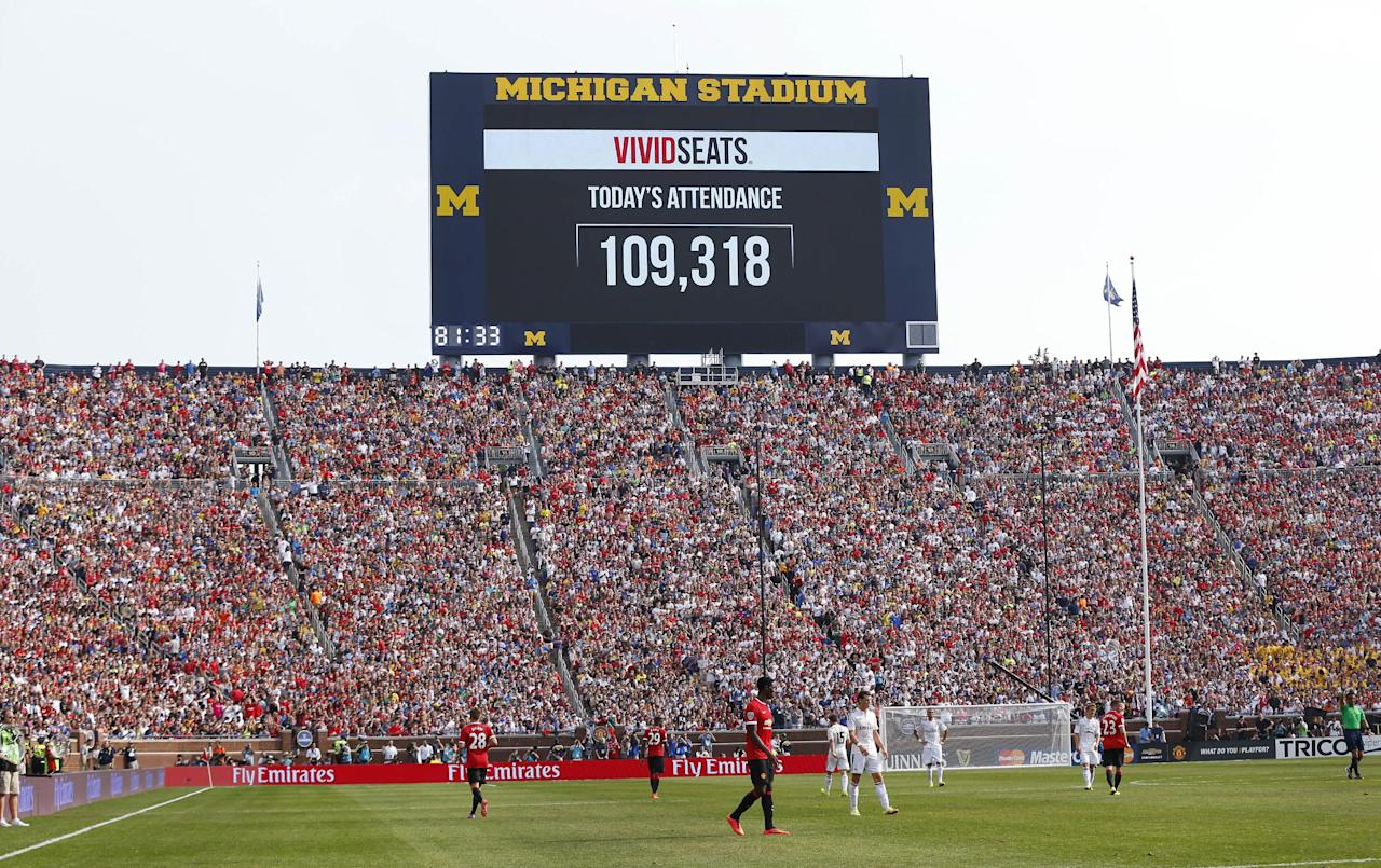 The scoreboard announces attendance of 109,318 during a Guinness International Champions Cup soccer match between Real Madrid and Manchester United at Michigan Stadium in Ann Arbor, Mich., Saturday, Aug. 2, 2014. Manchester United won 3-1. (AP Photo/Paul Sancya)