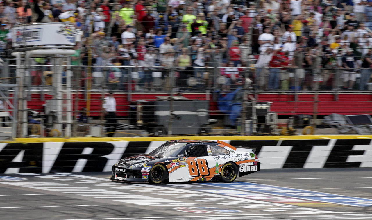 Dale Earnhardt Jr takes the checkered flag to win the NASCAR Sprint Showdown All-Star auto race in Concord, N.C., Saturday, May 19, 2012. (AP Photo/Terry Renna)