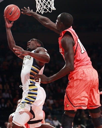 Louisville turns over No. 9 Marquette in 84-71 win