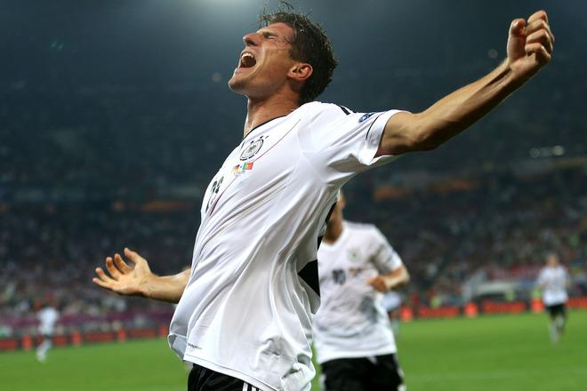 L'VIV, UKRAINE - JUNE 09:  Mario Gomez of Germany scores their first goal during the UEFA EURO 2012 group B match between Germany and Portugal at Arena Lviv on June 9, 2012 in L'viv, Ukraine.  (Photo by Joern Pollex/Getty Images)