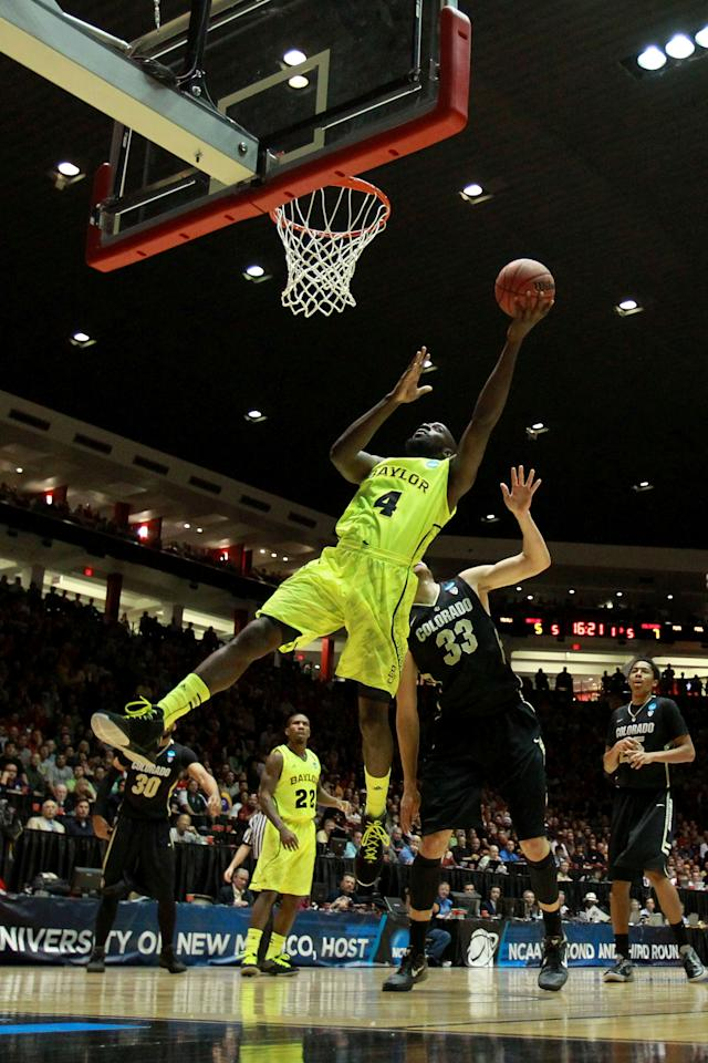 ALBUQUERQUE, NM - MARCH 17:  Quincy Acy #4 of the Baylor Bears shoots against Austin Dufault #33 of the Colorado Buffaloes in the first half during the third round of the 2012 NCAA Men's Basketball Tournament at The Pit on March 17, 2012 in Albuquerque, New Mexico.  (Photo by Ronald Martinez/Getty Images)