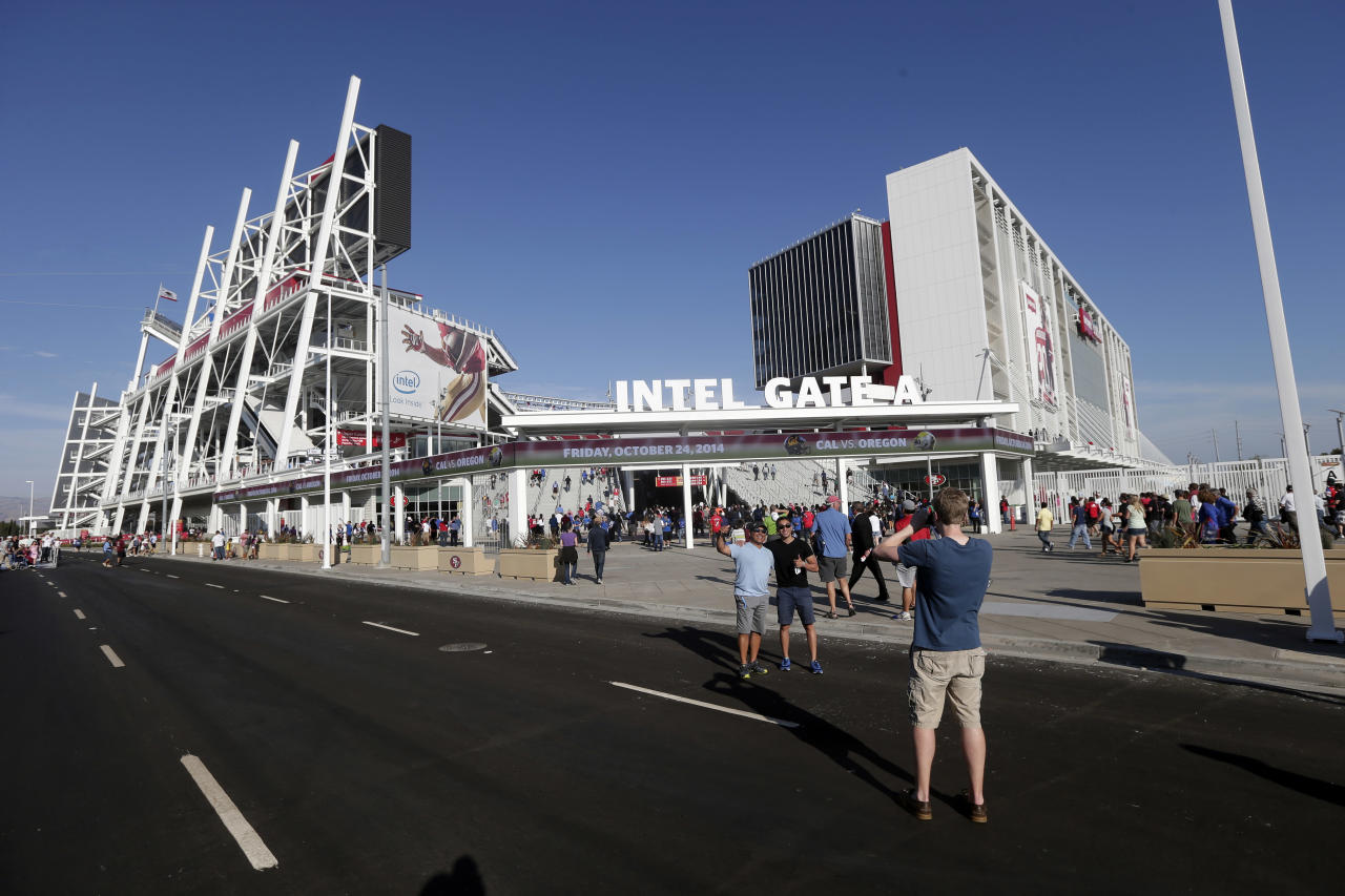 Fans take pictures outside the new Levi's Stadium before an MLS soccer match between the San Jose Earthquakes and the Seattle Sounders on Saturday, Aug. 2, 2014, in Santa Clara, Calif. (AP Photo/Marcio Jose Sanchez)