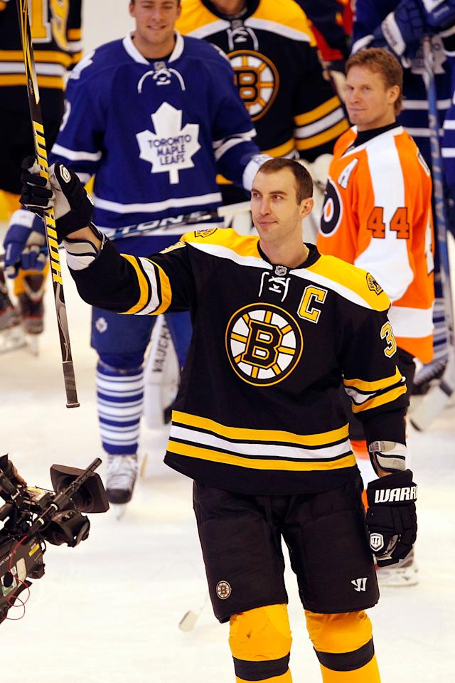 OTTAWA, ON - JANUARY 28:  Zdeno Chara #33 of the Boston Bruins and Team Chara celebrates after hitting the puck 108.8 MPH during the Blackberry NHL Hardest Shot part of the 2012 Molson Canadian NHL All-Star Skills Competition at Scotiabank Place on January 28, 2012 in Ottawa, Ontario, Canada.  (Photo by Gregory Shamus/Getty Images)