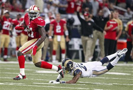 San Francisco 49ers Frank Gore gets past St. Louis Rams Rodney McLeod to run in a touchdown during their NFL football game in St. Louis