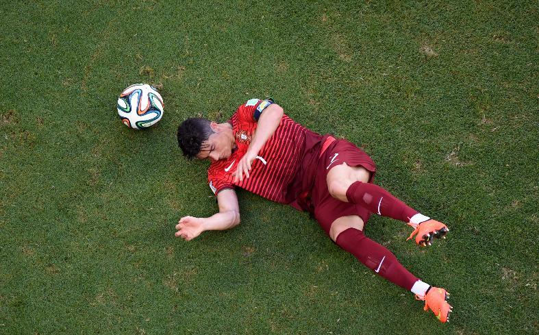 Portugal's Cristiano Ronaldo sits on the pitch during the group G World Cup soccer match between Germany and Portugal at the Arena Fonte Nova in Salvador, Brazil, Monday, June 16, 2014.  (AP Photo/Francois Marit, pool)