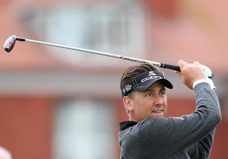 British golfer Ian Poulter drives from the fourth tee box during a practice round the Royal Liverpool Golf Course in Hoylake, north-west England, on July 14, 2014