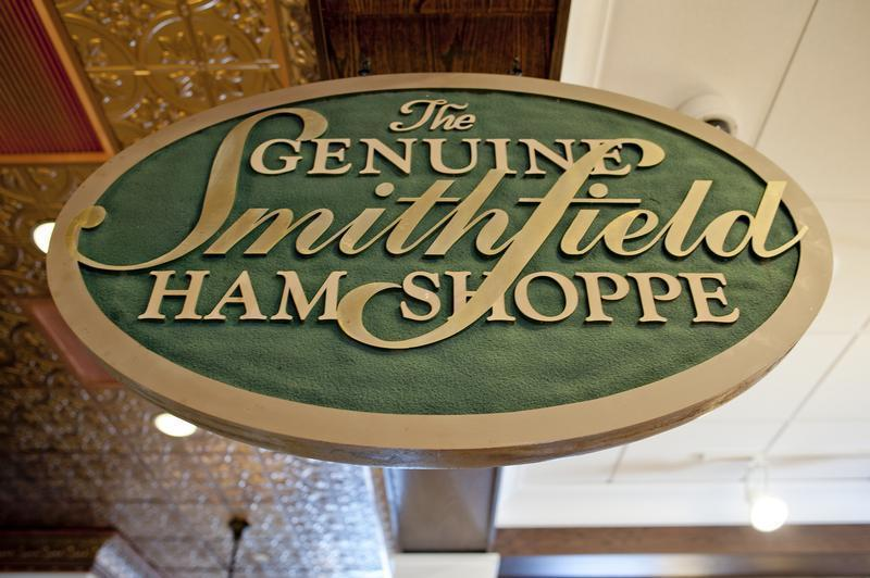 A sign advertising Smithfield hams hangs at the Taste of Smithfield restaurant and gourmet market in Smithfield, Virginia
