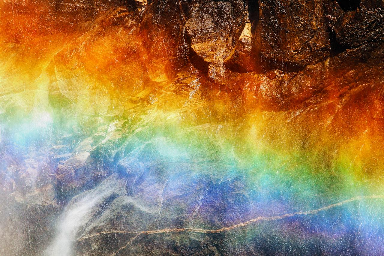 PIC BY NOLAN NITSCHKE / CATERS NEWS - (PICTURED A stunning rainbow in Yosemite) This is the spectacular moment a photographer struck gold - by capturing a bolt of lightning cracking through a rainbow in a freak weather display. The extraordinary one-of-a-kind sighting was captured by keen photographer Nolan Nitschke, 27, while on a trip to Yosemite National Park in California, USA. Nolan knew a storm was approaching the area and that the incredible rocky peaks throughout the park act as lightning rods but had no idea he would capture such a breathtaking moment. After spending hours painstakingly trying for the perfect shot he finally hit the jackpot as the bright lightning crashed through the colourful rainbow lighting up the dark sky. SEE CATERS COPY